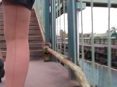 Girl in seamed stockings going upstairs
