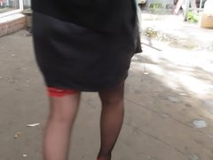 Black stockings with red tops outdoor