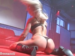 Slutty girl getting naughty in front of the crowd