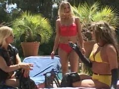 Lesbian threesome sizzles under the sun