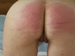 Finishing a whipping session with the cane