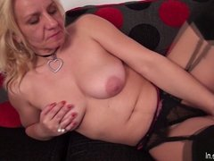 Naughty housewife playing with her pussy on the couch