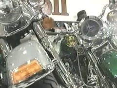 Two babes gangbanged in a motorcycle dealer