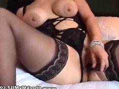Hot amateur MILF in black stockings masturbating