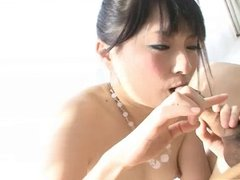 Adorable Rika plays with a cock and her tits before sucking