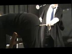 BDSM Caning - Six Over Trousers
