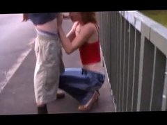 Redhead street whore serves customer outdoor