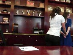 Horny lesbian finger fucks her girlfriend's cunt in an office