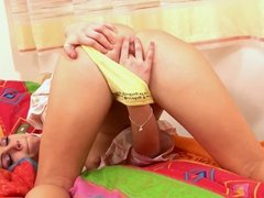Young blonde in pigtails inserts bright yellow banana dildo in her vag