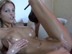 Oiled blonde fucks herself with her high heels