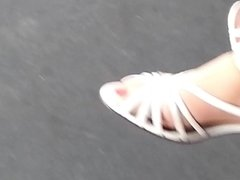 granny with nylon sock and long red toenails
