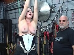 Fat white slut bound and humiliated in a torture chamber