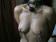 Slave has fishhooks in tits