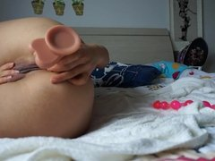 Amateur Asian teen uses several toys and anal beads