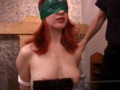 Smoking hot redhead with a nice rack into BDSM