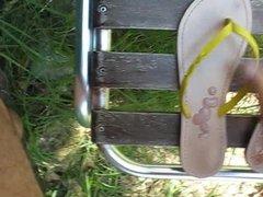 Outdoor Cumshot on soles of flip flop 001