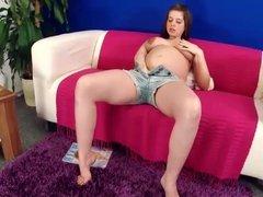 Pregnant Girl Toying On Sofa