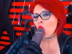 Mature Redhead With Glasses Sucking Dildo