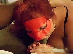 Masked MILF deepthroating
