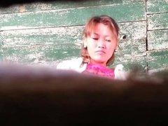 Girls write in street toilet 12