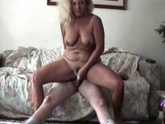 Hot milf rides the cock on the sofa