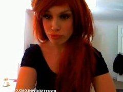 Big tits readhead posing to the webcam