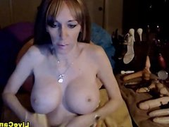 Busty milf showing off her new big boobs on w