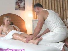 Tattooed massage babe rubs masseurs cock
