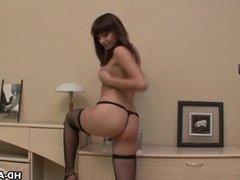 Half naked brunette teen fingering her erect