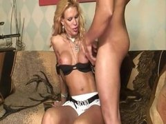 Busty blonde tranny fucked with a huge cock