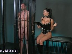 Caged sub gets handjob by mistress