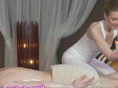 Classy masseuse jerking client cock