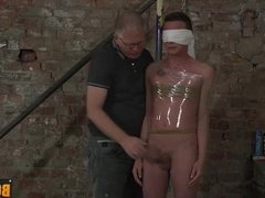 Cameron James getting wrapped in plastic
