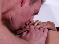 Busty student sucking huge cock