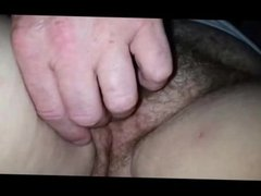 Fingering a fat hairy pussy closeup
