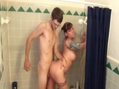 Nerdy dude fucking busty babe in the bathroom