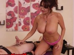 Mature femdom masseuse gives a mean handjob