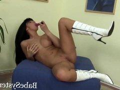Long Legs brunette masturbates her pussy wit