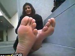 Girl Teasing Her Feet Outside
