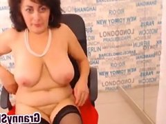 Granny In Stockings Rubs Her Pussy