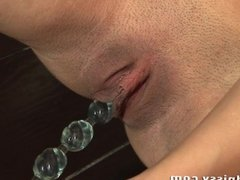 Glass dildo action in the shower room