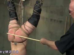 Hanged upside down slave big ass caned