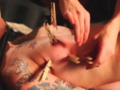 Tattooed babe gets tits clamped