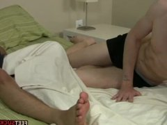Hunky foot buddies having fun in the bed