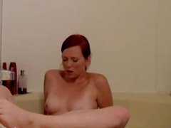 Redhead Squirts and Orgasms with Water Jet