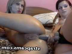 Lesbian fucking with strapon on webcam