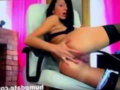 Stunning brunette babe fingering her sexy ass