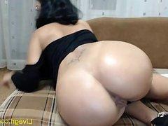 Sexy MILF performs anal masturbation