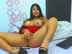 Busty latina plays with her pussy on webcam
