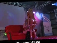 Blonde lesbians toying on live stage